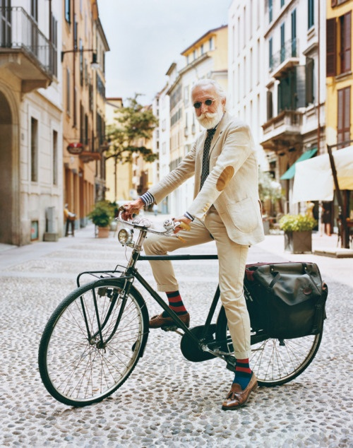 a suit on a bike with bespoke socks. you must be European. please be European.